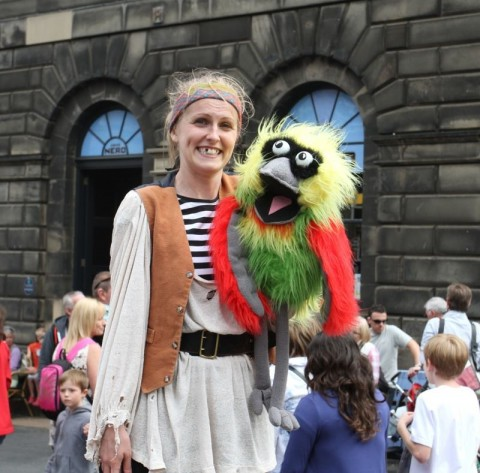 Actor with parrot at Edinburgh Festival