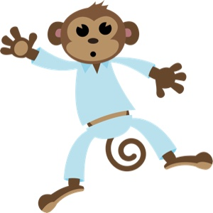 Monkey in pyjamas jumping on bed